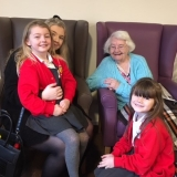 Local primary school pupils put smiles on faces of Birch Green Care Home residents